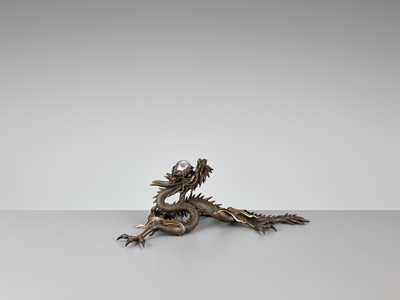 Lot 25-A BRONZE OKIMONO OF A DRAGON WITH ROCK CRYSTAL BALL