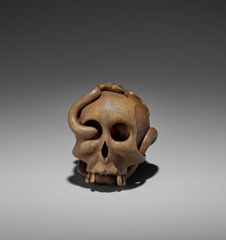 188 - SUKEYUKI: A MASTERFUL WOOD OKIMONO OF A SNAKE AND SKULL