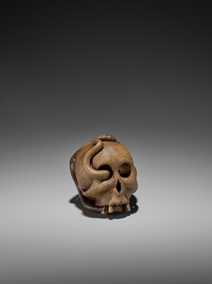 Lot 188 - SUKEYUKI: A MASTERFUL WOOD OKIMONO OF A SNAKE AND SKULL