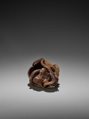 Lot 188-SUKEYUKI: A MASTERFUL WOOD OKIMONO OF A SNAKE AND SKULL