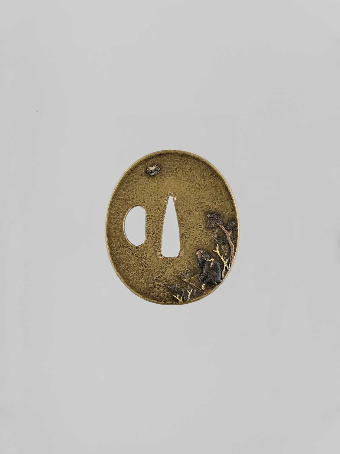 Lot 40 - AN INLAID SENTOKU TSUBA WITH A MONKEY AND BUTTERFLY
