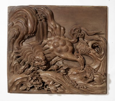Lot 119 - A MASSIVE AND FINELY CARVED WOOD PANEL WITH SHISHI AND CUB