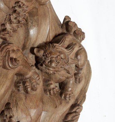 A MASSIVE AND FINELY CARVED WOOD PANEL WITH SHISHI AND CUB