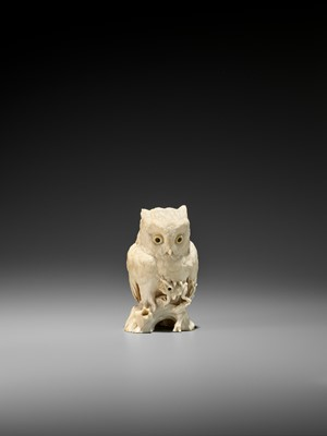 Lot 120 - RYUSAI: AN IVORY OKIMONO OF AN OWL CATCHING A FROG