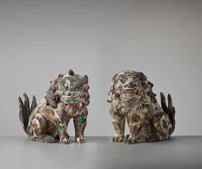 Lot 147 - A RARE PAIR OF KAMAKURA PERIOD POLYCHROME WOOD FIGURE OF BUDDHIST LIONS