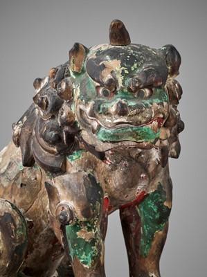 Lot 147 - A RARE PAIR OF KAMAKURA PERIOD POLYCHROME WOOD FIGURE OF BUDDHIST LIONS