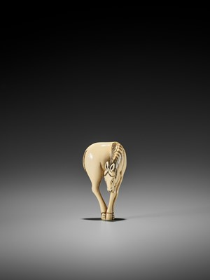 Lot 23-AN IVORY NETSUKE OF A STANDING HORSE