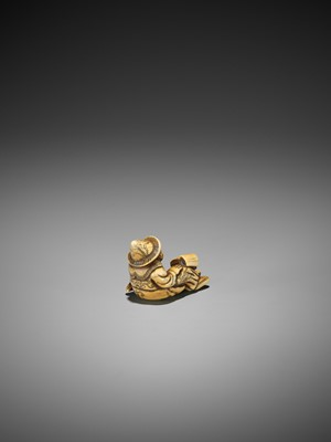 Lot 24-A RARE AND EARLY IVORY NETSUKE OF A SEATED DUTCHMAN READING