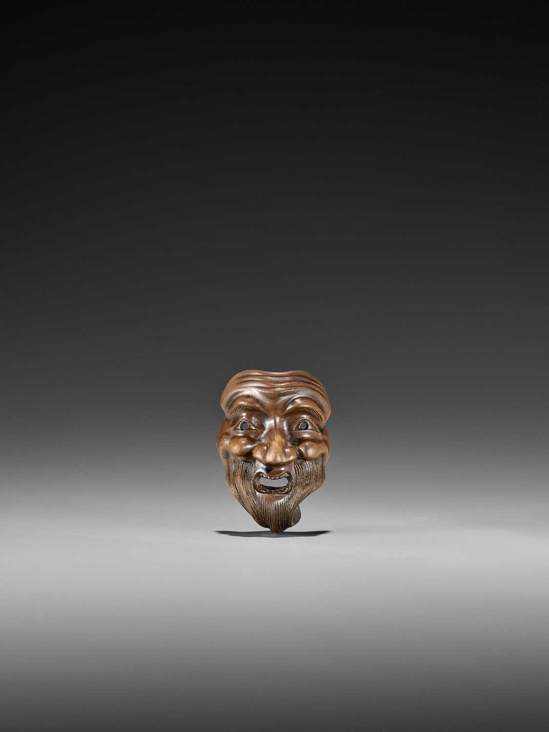235 - NAITO TOYOMASA: AN IMPORTANT WOOD MASK NETSUKE OF WARAI JO TYPE DEPICTING A SELF-PORTRAIT OF THE ARTIST, THE REVERSE CARVED AS HIS GHOST