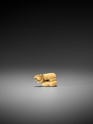 Lot 30-AN EARLY AND AMUSING IVORY NETSUKE OF CHOKARO'S HORSE STUCK IN A GOURD