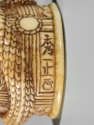 Lot 37-HIDEMASA: A FINE IVORY NETSUKE OF KIYOHIME