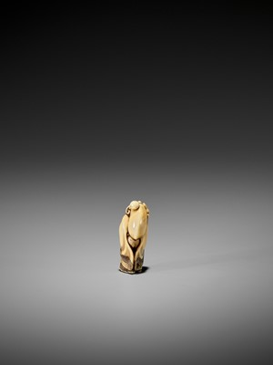 Lot 38-HIDEMASA: A RARE IVORY NETSUKE OF FUKUROKUJU PLAYING KEMARI