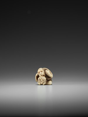 Lot 50 - RANMEI: AN IVORY NETSUKE OF A MONKEY WITH PERSIMMON