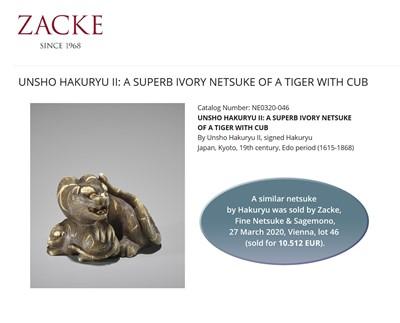 Lot 63-UNSHO HAKURYU II: A SUPERB IVORY NETSUKE OF A TIGER WITH TWO CUBS
