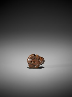 Lot 17-AN EARLY WOOD NETSUKE OF A TOAD