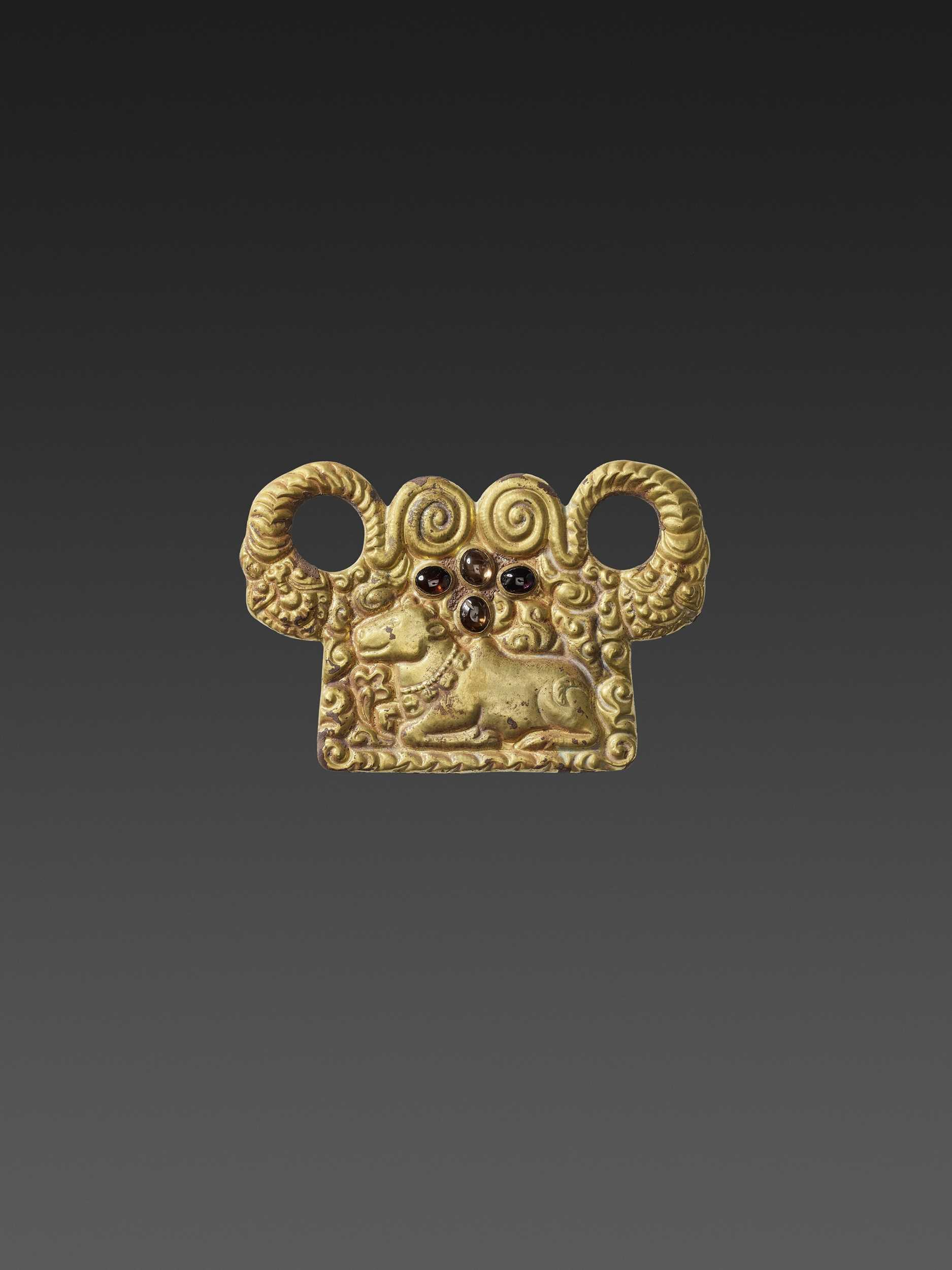 Lot 2-A CHAM ZIRCON AND AMETHYST-SET GOLD REPOUSSÉ PECTORAL DEPICTING NANDI AND NAGAS