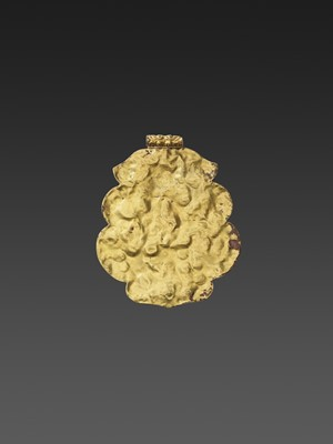 Lot 7-A CHAM GEMSTONE-SET GOLD REPOUSSÉ PENDANT DEPICTING GANESHA DANCING