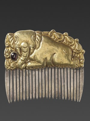 Lot 11-A CHAM GEMSTONE-SET GOLD REPOUSSÉ AND SILVER HAIR COMB WITH A RECUMBENT ELEPHANT