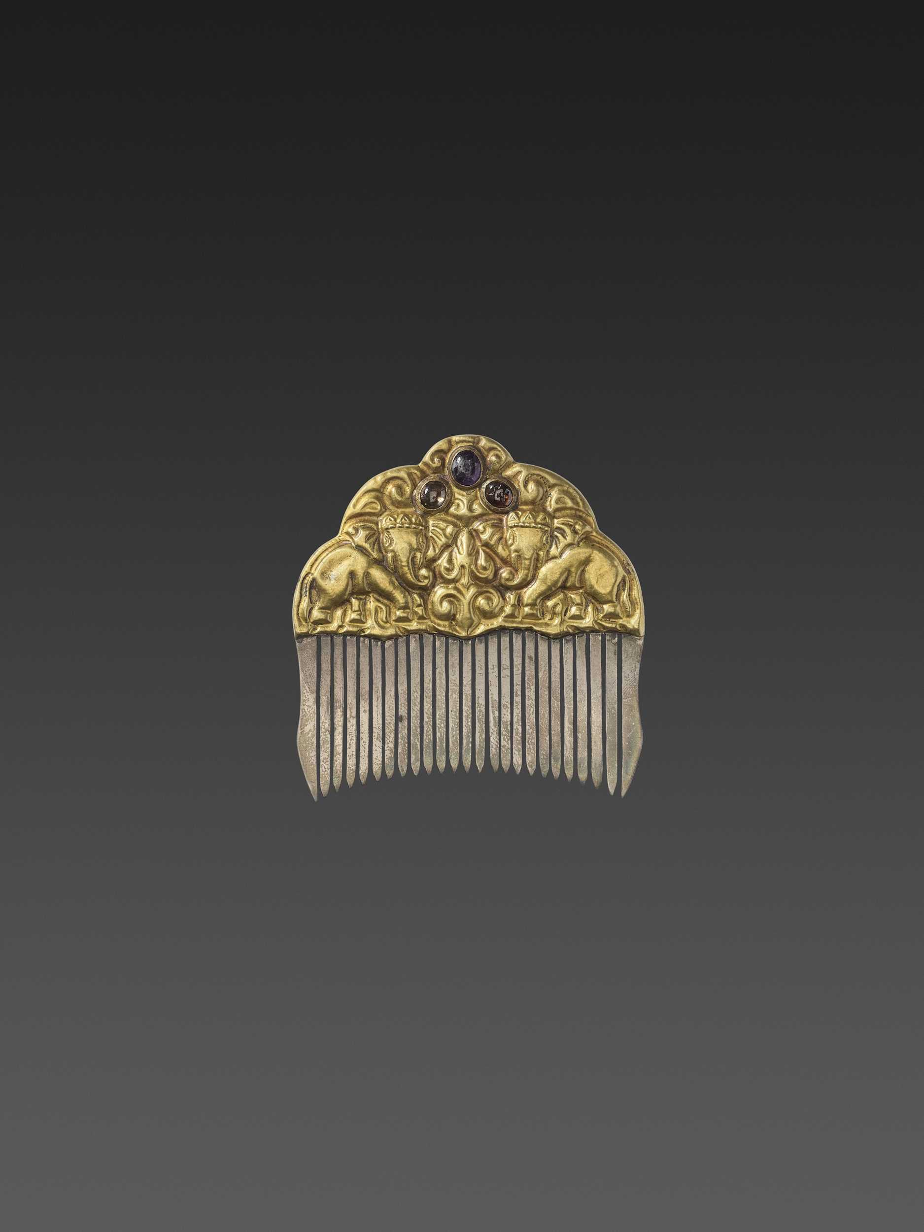 Lot 12-A CHAM GEMSTONE-SET GOLD REPOUSSÉ AND SILVER HAIR COMB WITH ROYAL ELEPHANTS