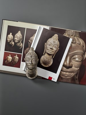 Lot 37-A VERY FINE AND RARE GEMSTONE-SET CHAM SILVER HEAD OF SHIVA