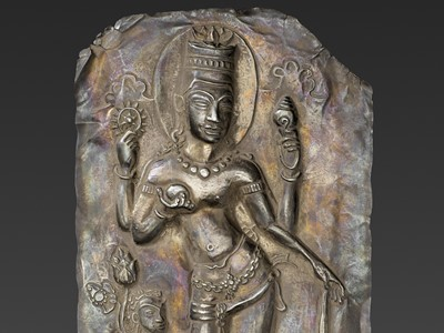 Lot 40-A LARGE CHAM SILVER REPOUSSÉ PLAQUE DEPICTING VISHNU AND CHILD