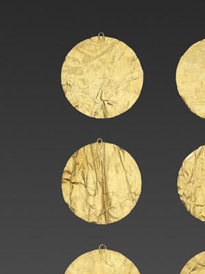 SIX BACTRIAN GOLD DISKS