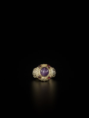 Lot 68-A CHAM AMETHYST AND GARNET-SET GOLD REPOUSSÉ RING WITH KING'S HEADS