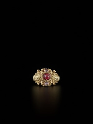 Lot 70-A CHAM RUBY AND AMETHYST-SET GOLD REPOUSSÉ RING WITH KALA MASKS