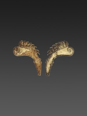 A PAIR OF INDONESIAN GOLD CROWN ORNAMENTS