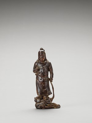 Lot 593 - A GILT AND LACQUERED WOOD FIGURE OF A HEAVENLY KING, MING