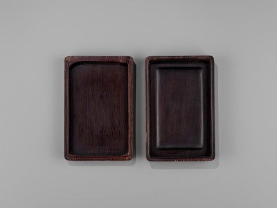 Lot 31 - AN INSCRIBED DUAN INKSTONE AND FITTED HUANGHUALI BOX, QING