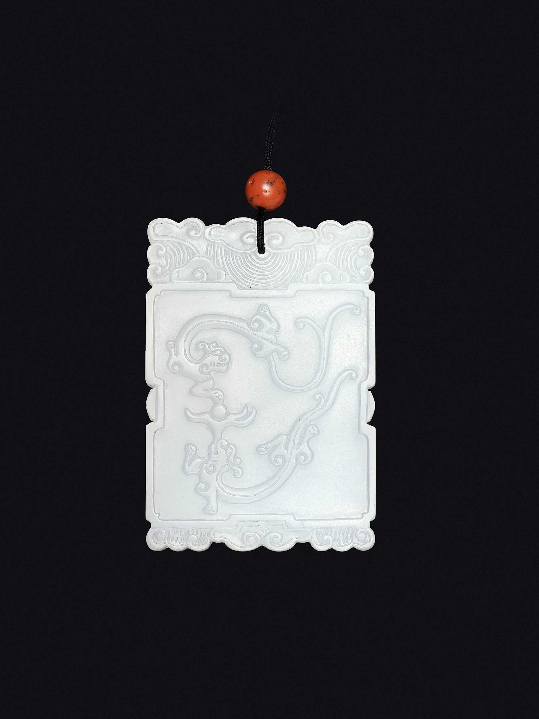 Lot 93 - A WHITE JADE 'FUGUI' PLAQUE, MID-QING TO REPUBLIC