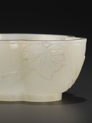 Lot 63 - AN IMPERIAL WHITE JADE 'HAITANG' BRUSHWASHER, WITH A POEM BY CHEN YUYI, YONGZHENG MARK AND PERIOD