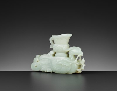 Lot 68 - A WHITE JADE ARCHAISTIC PHOENIX-FORM INCENSE HOLDER, QIANLONG