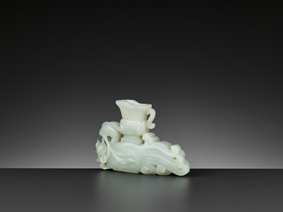 Lot 68 - A WHITE JADE ARCHAISTIC PHOENIX-FORM INCENSE HOLDER, QIANLONG