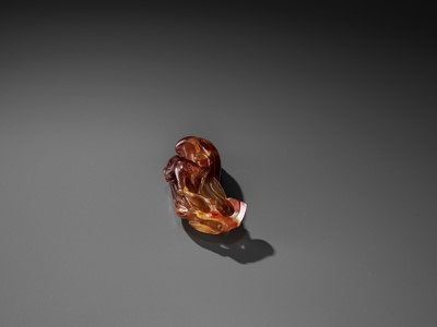 Lot 37 - A FINE AGATE 'MELON AND BOY' GROUP, QING