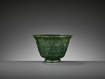 Lot 75 - A LOBED SPINACH-GREEN JADE 'CHRYSANTHEMUM' BOWL, QING