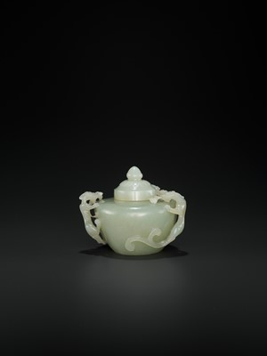 Lot 104 - AN OPENWORK PALE CELADON JADE 'CHILONG' WATER POT AND COVER, QING
