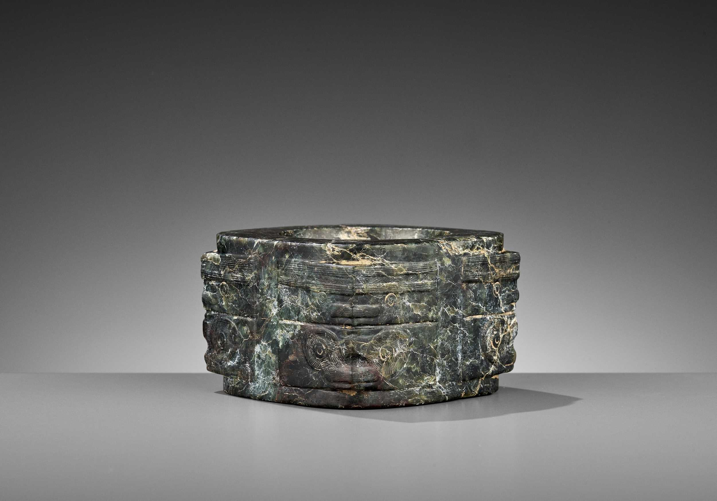 Lot 50 - A MOTTLED GREEN JADE CONG, LIANGZHU CULTURE