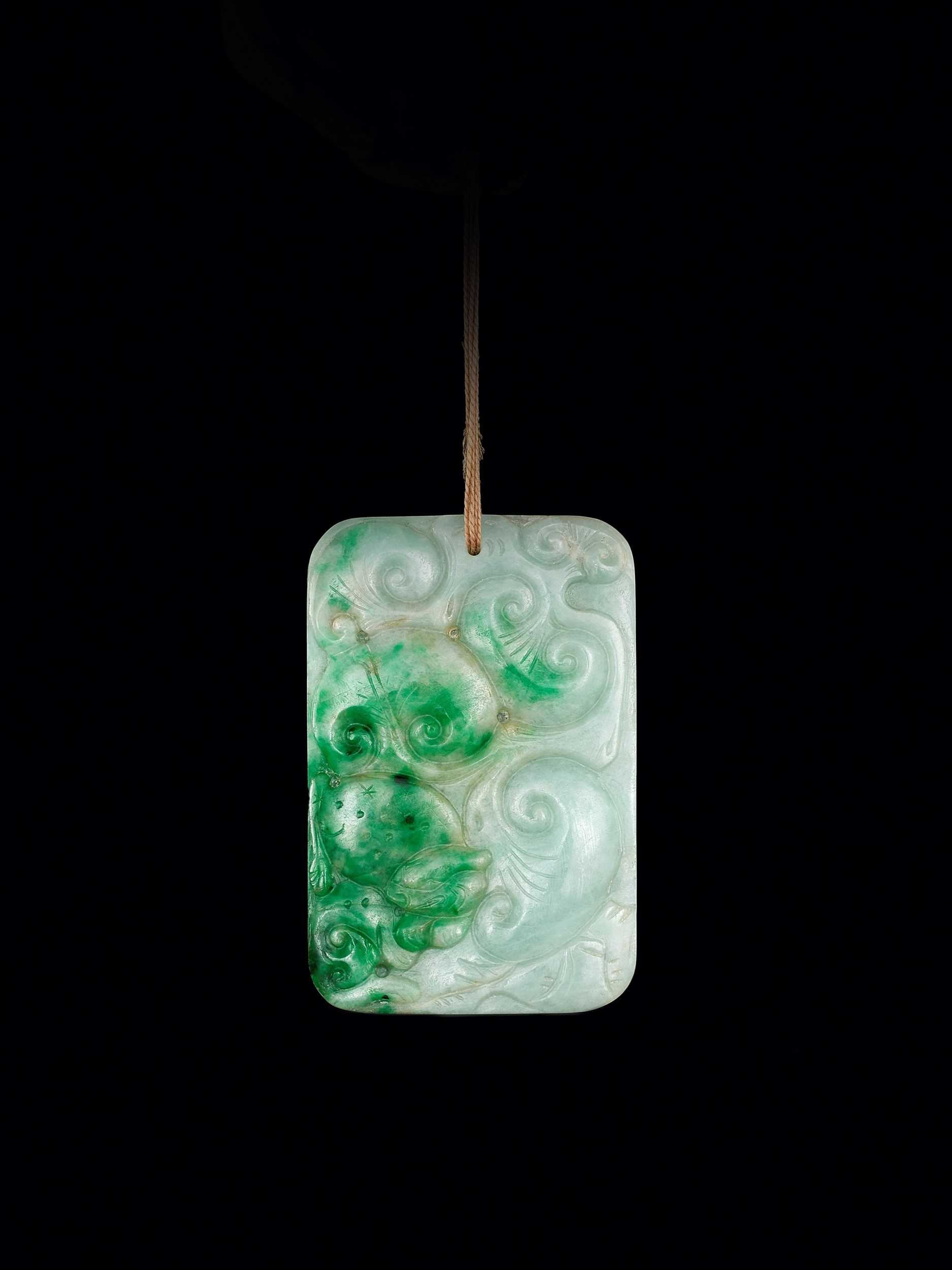 Lot 89 - AN APPLE- AND EMERALD-GREEN JADEITE 'LINGZHI' PLAQUE, QING DYNASTY