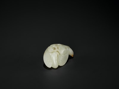 Lot 94 - A WHITE JADE 'PHOENIX' WEIGHT, QIANLONG