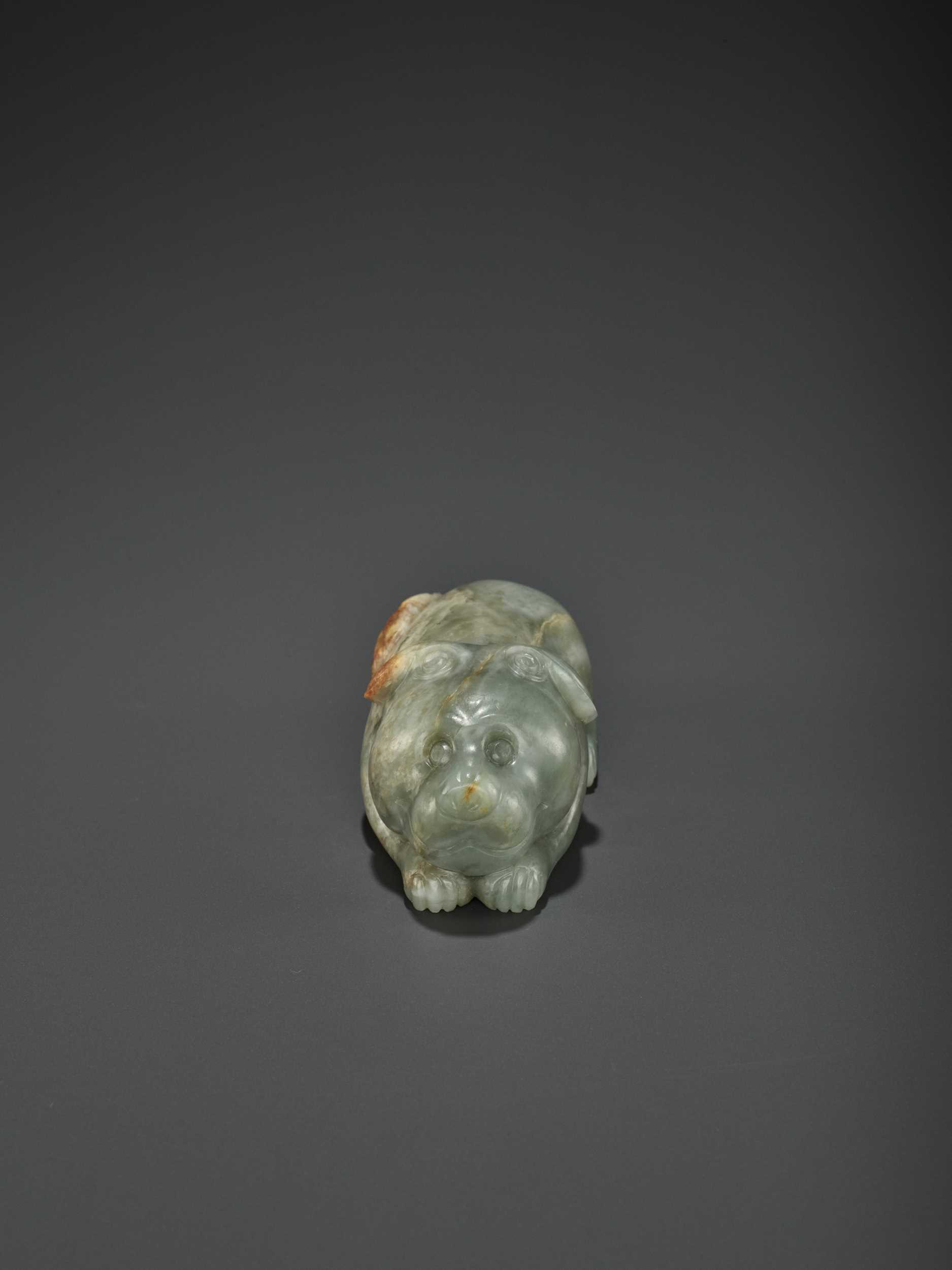 Lot 72 - A CARVED CELADON AND RUSSET JADE FIGURE OF A DOG, LATE MING DYNASTY