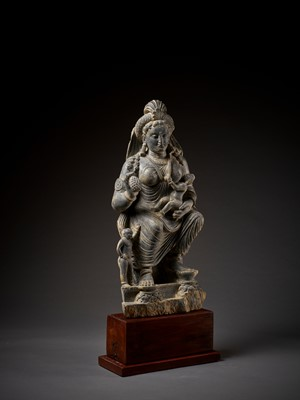 Lot 686 - A HIGHLY IMPORTANT AND LARGE SCHIST STATUE OF HARITI, GANDHARA, 2ND-3RD CENTURY