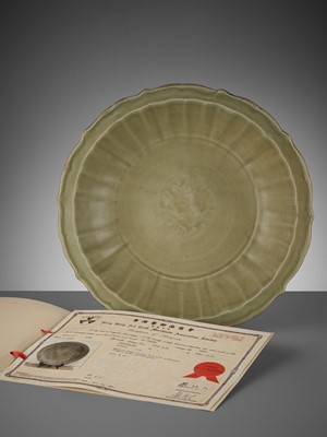 Lot 205 - A LOBED LONGQUAN CELADON-GLAZED BARBED-RIM CHARGER, MING