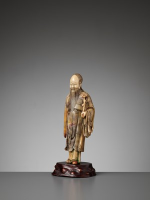 Lot 38 - A CARVED SOAPSTONE FIGURE OF SHOULAO, MID-QING