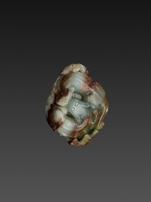 Lot 84 - A CELADON AND RUSSET JADE 'CHILONG' PENDANT, QING DYNASTY