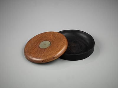 Lot 32 - A DUAN INKSTONE WITH A JADEITE-INSET HUANGHUALI COVER, QING