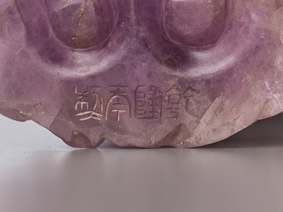 Lot 41 - A CARVED AMETHYST FIGURE OF GUANYIN, QIANLONG MARK AND OF THE PERIOD