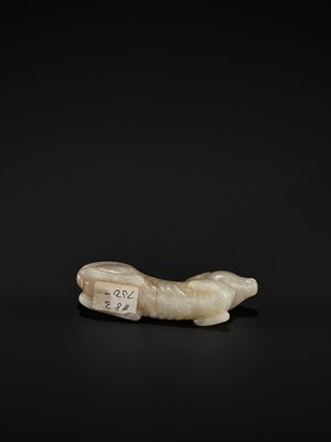 Lot 79 - A PALE GRAY JADE FIGURE OF A RECUMBENT HOUND, TANG TO SONG DYNASTY