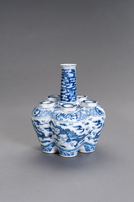 Lot 390 - A BLUE AND WHITE PORCELAIN 'DRAGONS' TULIP VASE, QING DYNASTY